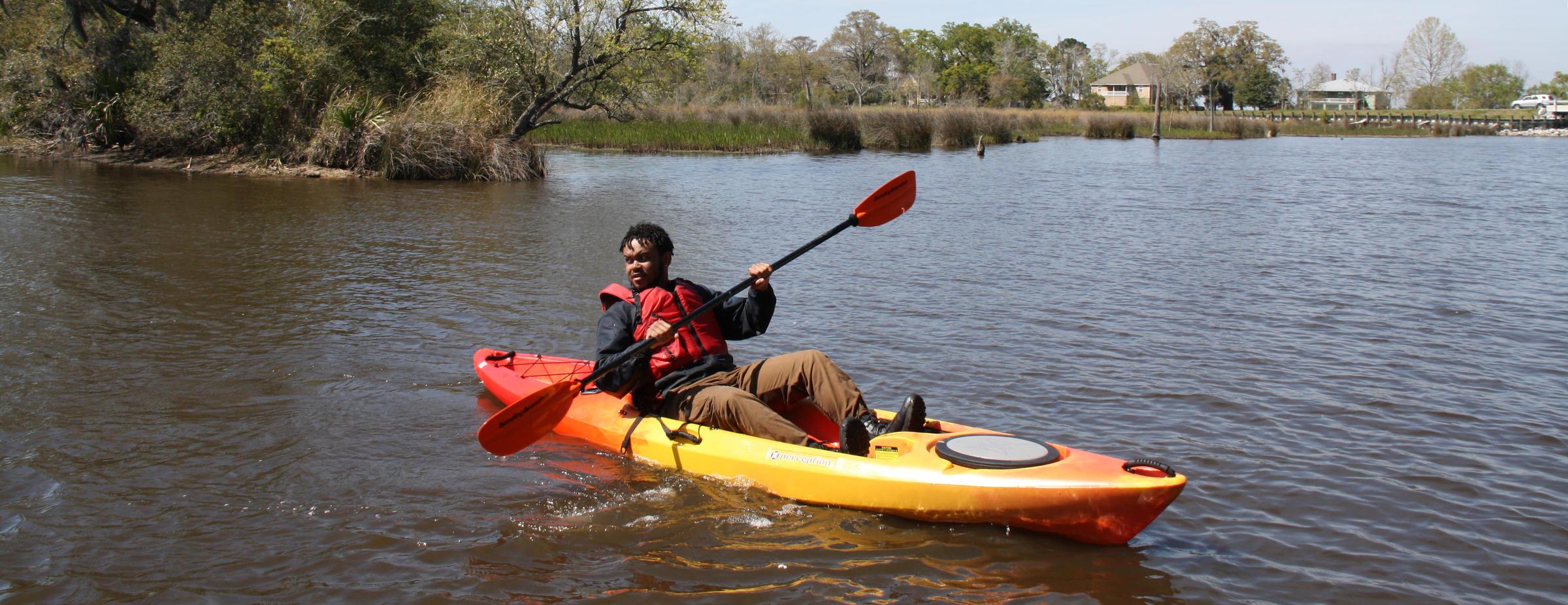 Man kayaks the bayou